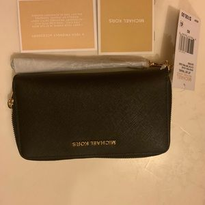 Brand new Michael Kors black wallet with tags!